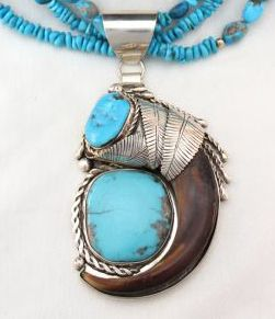 Grizzly Bear Claw Pendant with large Turquoise in Sterling Silver Setting